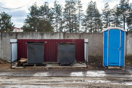 cesspool: old garbage containers and toilets Stock Photo