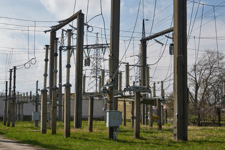 substation: Electric poles with wires and insulators on electrical substation