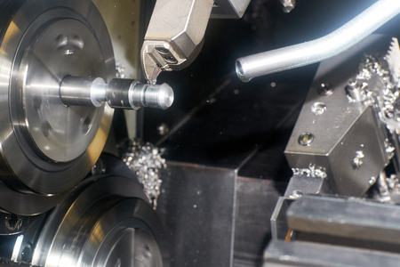 workpiece: Turning. Cutter CNC lathe to grind the groove on the workpiece Stock Photo