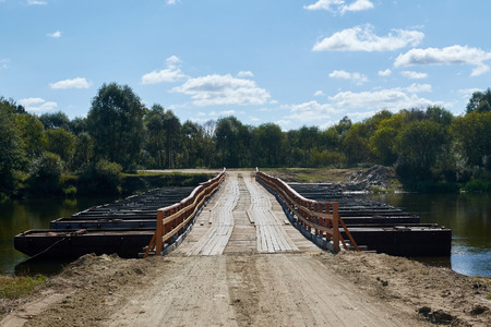 pontoon: pontoon bridge with wooden deck over the river Stock Photo