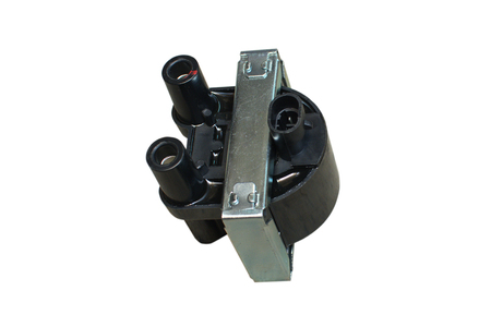 Ignition coil for gasoline four-cylinder internal combustion engine. Isolate on white. Banco de Imagens