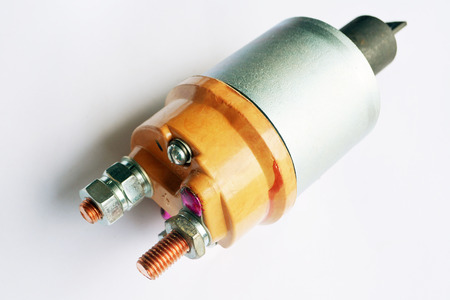 Tractor starter relay on isolated white background. New spare part.
