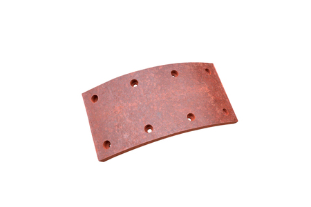 drilled brake lining pads of a truck on an isolated white background