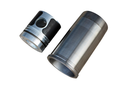 Spare parts pistons and cylinders for an internal combustion engine on a white background