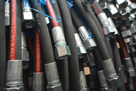 Stainless Steel Hydraulic Hoses Close Up. Industrial Background.