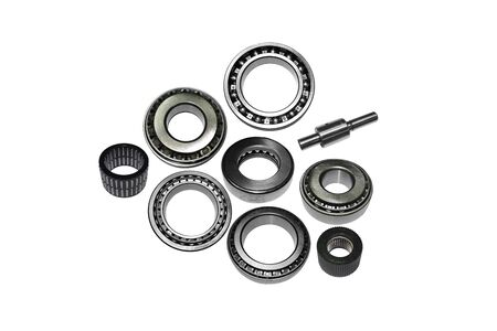 A series of automotive ball and roller bearings on white background.