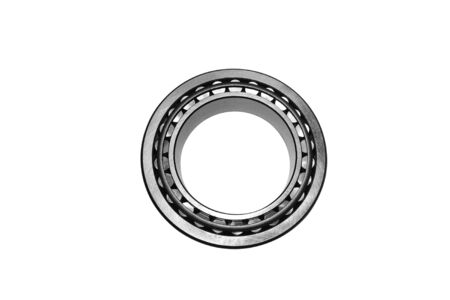 A close up of a bearing isolated on a white background. Banque d'images