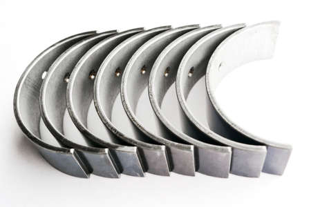 The crankshaft bearings of the car on an isolated white background. Spare parts.