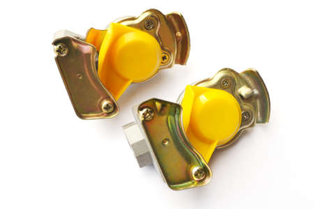 Pneumatic connecting heads with a valve on an isolated white background. Spare parts.