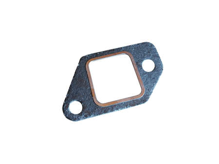 New automotive gasket for the exhaust system isolated on white background. Spare parts. Imagens