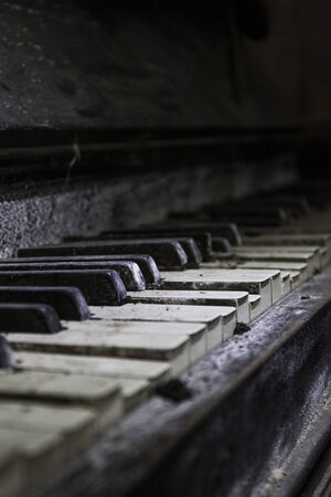 Close up of the keys of an old broken piano photo