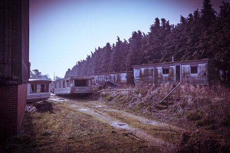 dilapidated: Rusty, old dilapidated holiday home trailer park