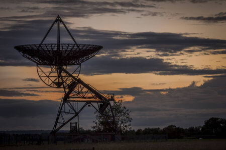 radio telescope: Silhouette of a radio telescope pointing upwards at the Sky at Dusk