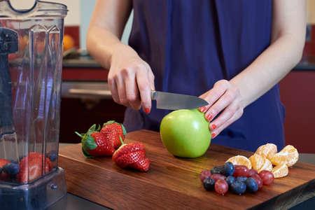 juicing: cutting fresh fruits for juicing