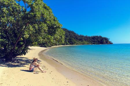 fiji: woman sitting on beach in Fiji