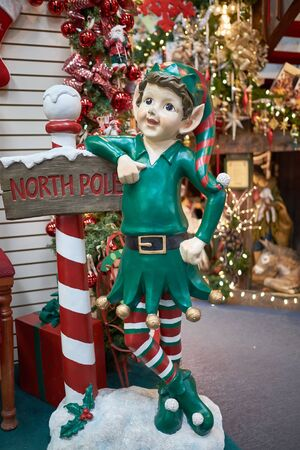 Large Christmas Elf figurine with North Pole sign