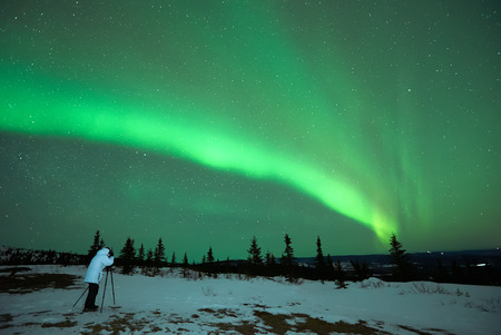 man photographing the Aurora Borealis