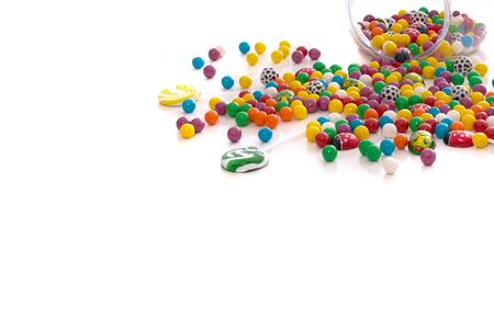 onto: multi colored candy spilled onto table