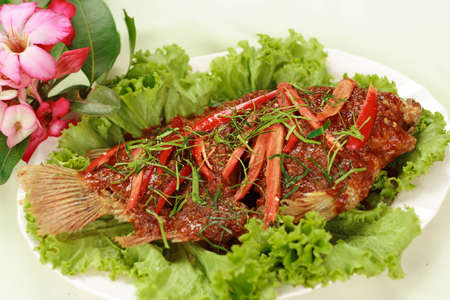 Fried fish with chilli sauce  photo