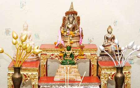 Many of the Buddha statue on the table Stock Photo