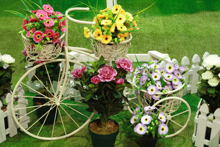 Artificial flowers and antique tricycle for decoration