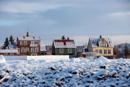 Three coloured houses with snow in Reykjavik, Iceland photo