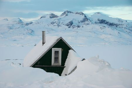 greenland: A green house in a snow-covered landscape, Greenland