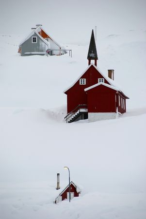 A snowbound inuit village, Tasiilaq, Greenland Stock Photo