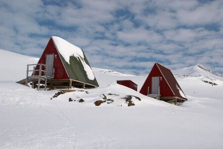 inuit: Two coloured inuit huts in snow, Greenland