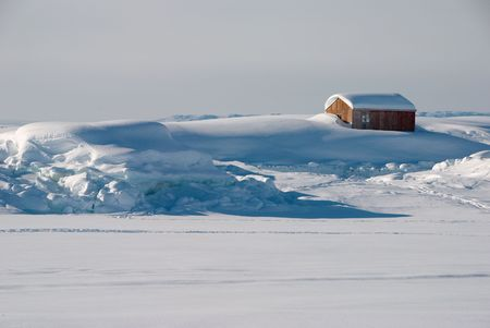 greenland: A wooden  in a snow-covered landscape, Greenland Stock Photo