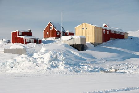 inuit: An inuit village with warehouses in a snowy landscape