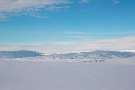 inuit: A small inuit village lost in a snowy landscape