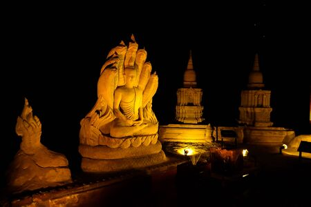 Buddha statue Buddha meditation dunes in the dark  Thailand photo