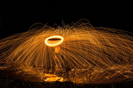 light trails: Abstract Image of Burning Wirewool being used to make circle like light trails at Night Stock Photo