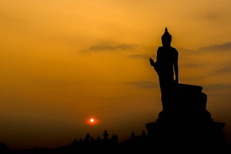 sleek: Buddha at sunset. When the evening sun is bright red. Lord Black is a sleek backlit. Public Art