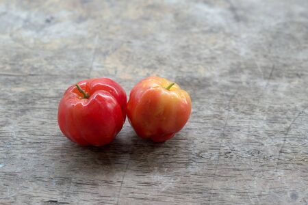l natural: Barbados Cherry on wood background Stock Photo