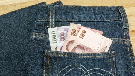 corruptible: Thai money ready to travel On the background Jeans Stock Photo