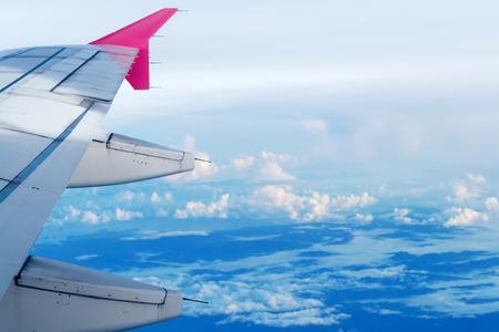 onto: image through aircraft window onto jet engine Stock Photo