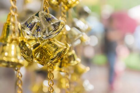 nakhon pathom: Prayer Bells. Thailand. Golden and bronze bell. Buddhist bells lucky charms in Thailand. If write name on belief you will luck and succeed. Wat Rai Khing, Nakhon Pathom. Thailand