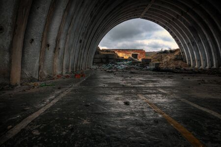 abandoned warehouse: Gloomy ruins of an abandoned military warehouse