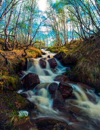 waterfall with sky: Spring rough Creek in the Arctic tundra. Beautiful waterfall Stock Photo