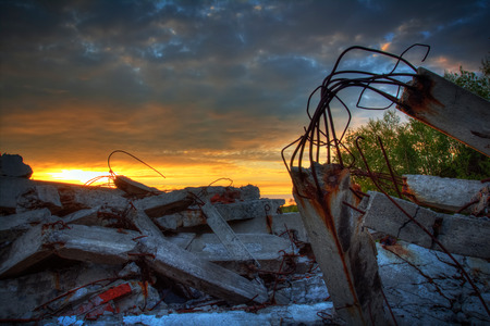 desolation: Sunset over the wreckage of buildings.