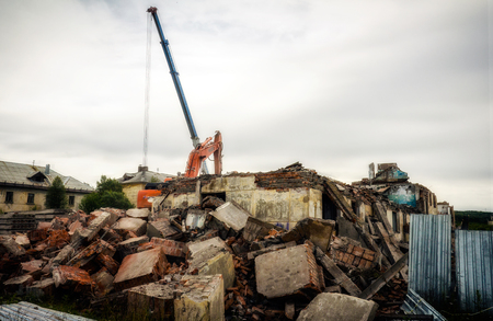 disassemble: Special machinery destroys old buildings