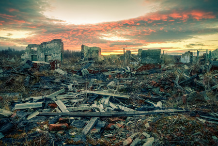 The remains of destroyed houses at sunset.Apocalyptic landscape