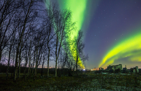 ionosphere: Northern lights in the sky over the ruins of an old building Stock Photo