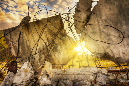 The debris of the damaged building on sunset sky background Stock Photo