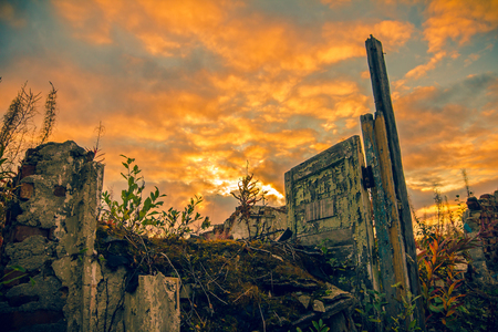 Destroyed building.The remains of destroyed houses at sunset