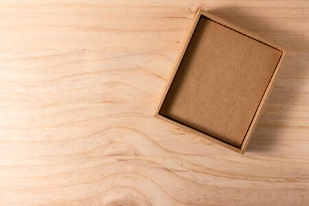 vintage objects: Opened cardboard box on wooden background
