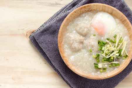 Save to a lightbox  Find Similar Images  Share Stock Photo: Asian congee with minced pork and egg in white bowl. Banco de Imagens