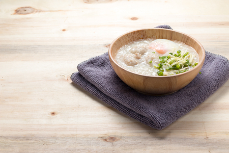 Save to a lightbox  Find Similar Images  Share Stock Photo: Asian congee with minced pork and egg in white bowl. Stock Photo
